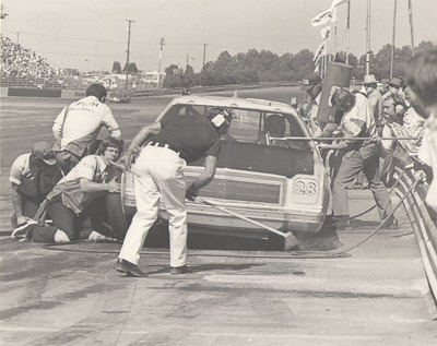 nascar pit stop charlotte motor speedway early 1970's tire changer windshield washer gas man